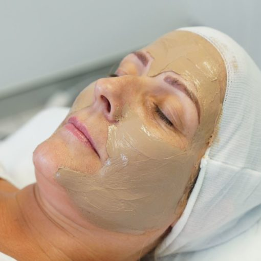 cosmelan mask applied to a woman's face