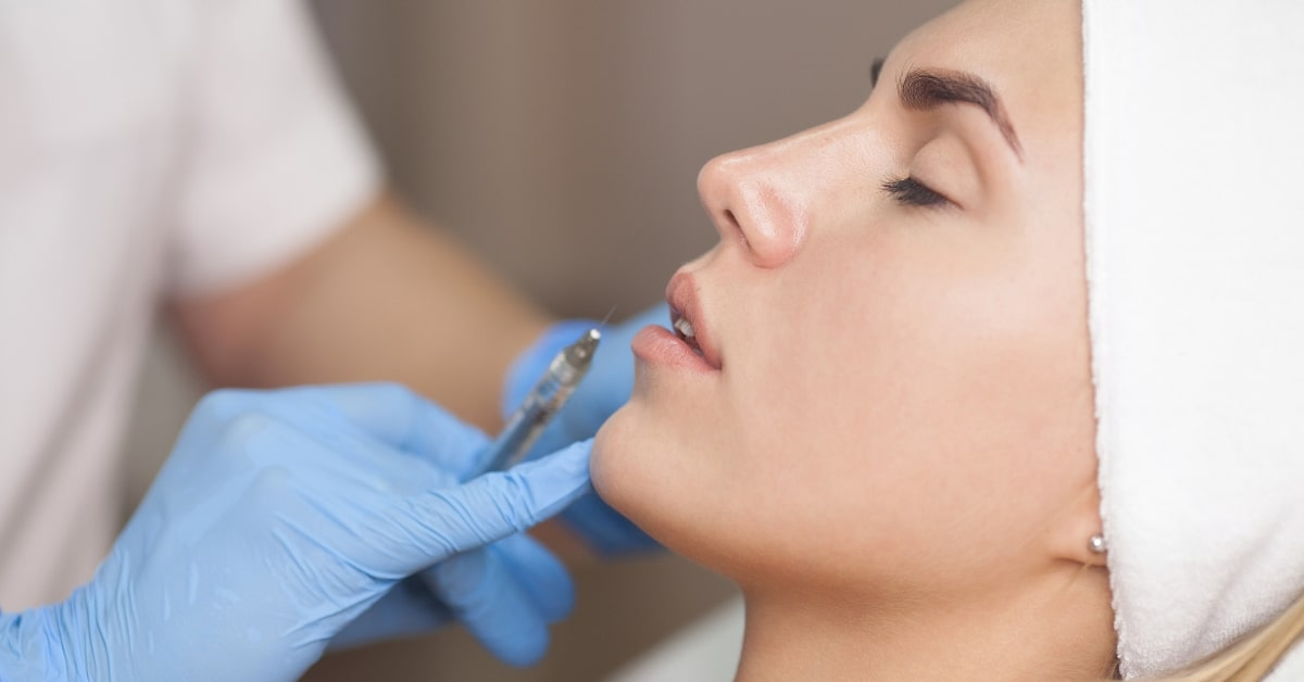 Dermal Filler Injectables - Consultant about to inject dermal filler into girls lips