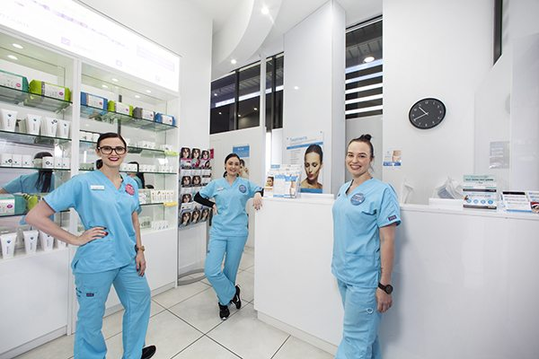 Helensvale Staff standing inside our laser hair & Skin Clinic Reception